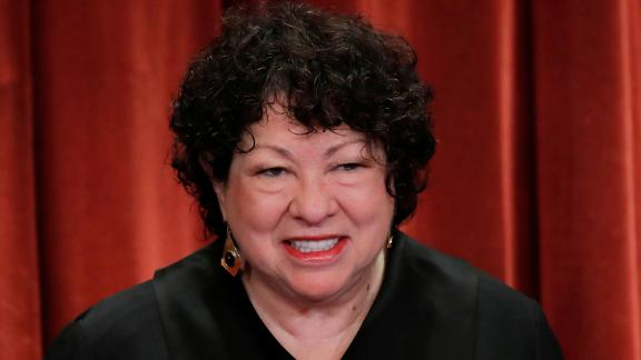 U.S. Supreme Court Associate Justice Sonia Sotomayor smiles during a group portrait session for the new full court at the Supreme Court in Washington, U.S., November 30, 2018. REUTERS/Jim Young