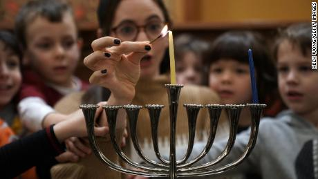 WASHINGTON, DC - NOVEMBER 30:  A small group of pre-schoolers from Gan HaYeled learn how to light a Hanukkah menorah from Rabbi Sarah Krinsky at Adas Israel Congregation November 30, 2018 in Washington, DC. This year, Hanuakka will begin at sundown on December 2 and last until sundown on December 10.  (Photo by Alex Wong/Getty Images)