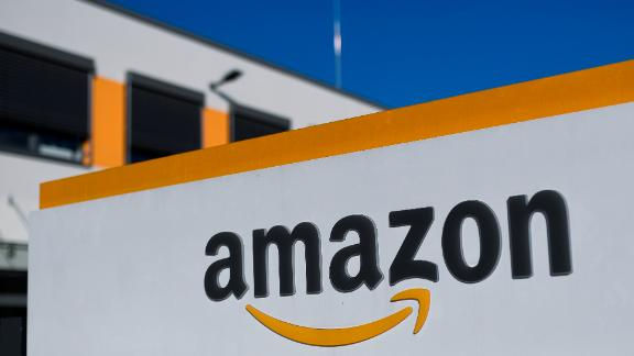 08 November 2018, North Rhine-Westphalia, Dortmund: The Amazon logo can be seen at the logistics centre. In Europe's first redistribution centre automated with conveyor technology, goods are received and distributed to other logistics centres of the Group in Europe. Photo by: Ina Fassbender/picture-alliance/dpa/AP Images
