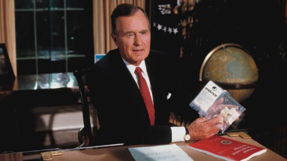 Bush holds up a plastic bag with crack cocaine during a televised speech about drugs in 1989. Weeks later it was revealed that government agents had bought the drugs from a dealer in front of the White House for the purpose of Bush's speech.