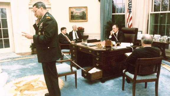 Bush and Colin Powell, the chairman of the Joint Chiefs of Staff, speak on separate phones in February 1991 while Joint Chiefs John Sununu, Robert Gates and Brent Scowcroft listen to a conversation about halting the Gulf War.