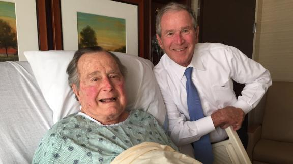 "Bush was admitted to a hospital in April 2017 for an acute respiratory problem stemming from pneumonia. This photo of him and his son George was posted to Twitter. ""Big morale boost from a high level delegation. No father has ever been more blessed, or prouder,"" the elder Bush wrote about the photo."