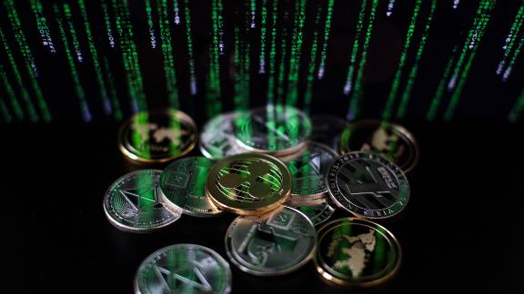 LONDON, ENGLAND - APRIL 25: In this photo illustration of the litecoin, ripple and ethereum cryptocurrency