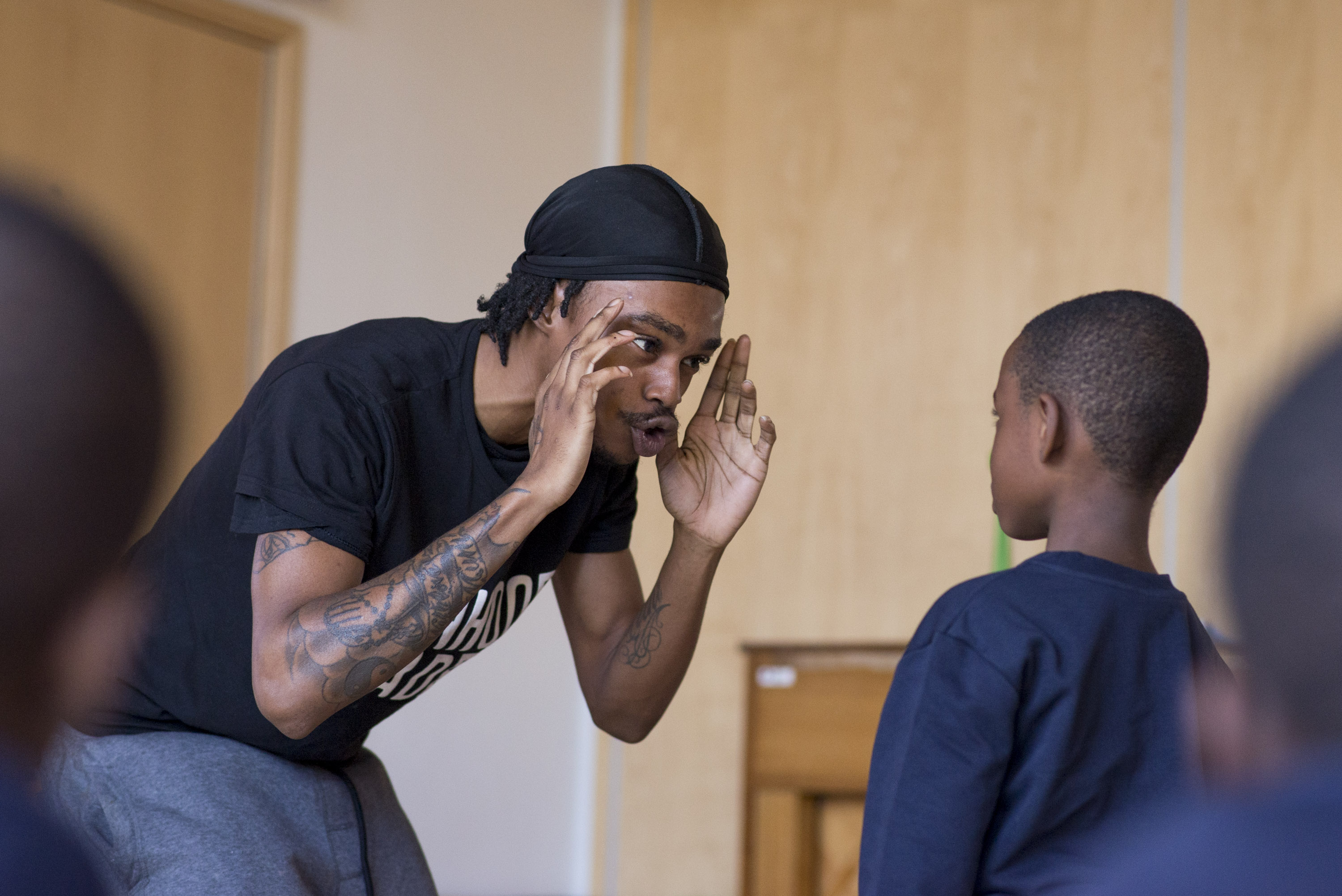 Freeman coaches a young Manhood Academy member on how to resist giving into peer pressure.