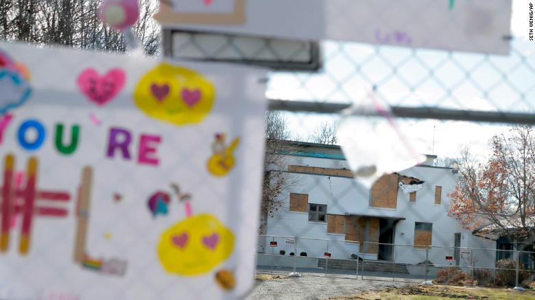 Tributes hung on a fence in front of the Colts Neck mansion.