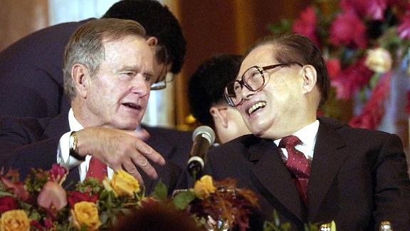 Former US President George Bush shares a laugh with then Chinese President Jiang Zemin in Houston, Texas, 23 October, 2002.