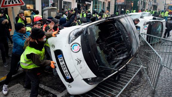 French gendarmes apprehend a protester in Paris on December 1.