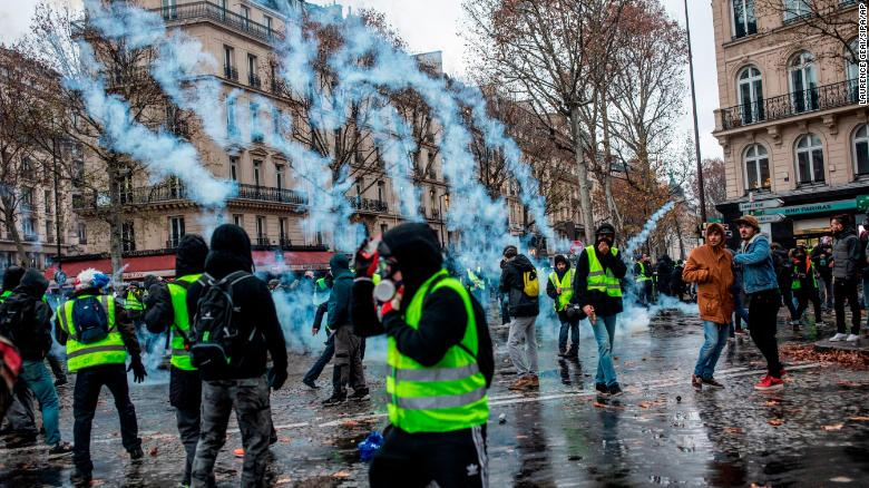 Protesters and police clash in downtown Paris during Saturday's national demonstration.