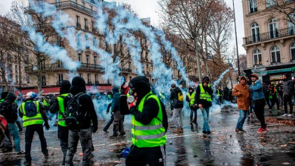 Protesters and police clash in downtown Paris on December 1 during a national demonstration.