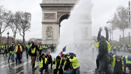 protesters wearing yellow vests a symbol of a french drivers protest against higher diesel