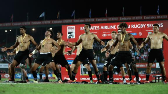 New Zealand players perform the haka after winning the Dubai Sevens title by defeating USA.