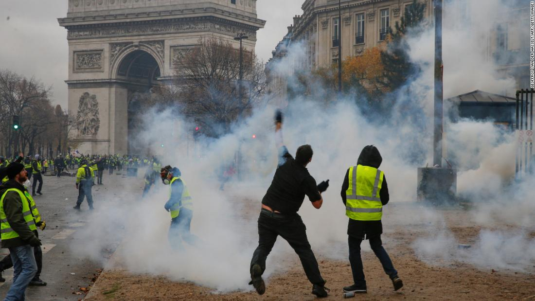 A demonstrator throws a projectile during the December 1 protest.