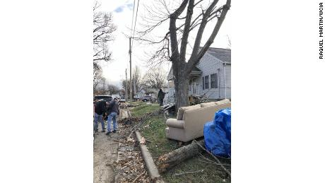 Taylorville neighbors go through the debris after the storm.