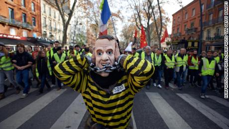 Macron relents amid violent protests in France