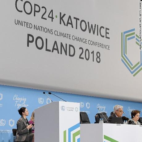 "Polish Secretary of State in the Ministry of Environment, Government Plenipotentiary for COP24 Presidency, Michal Kurtyka (on screen) speaks during the inaugural session  at the 24th Conference of the Parties to the United Nations Framework Convention on Climate Change (COP24) summit on December 2, 2018 in Katowice, Poland. - Representatives from nearly 200 countries began crunch UN climate talks in Poland against a backdrop of dire environmental warnings and a call for action against the ""urgent"" threats posed by climate change. (Photo by Janek SKARZYNSKI / AFP)        (Photo credit should read JANEK SKARZYNSKI/AFP/Getty Images)"