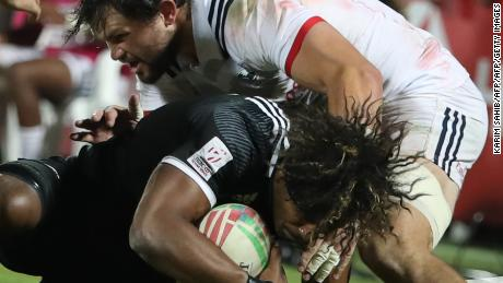 New Zealand's Luke Masirewa is tackled by USA's Ben Pinkelman.