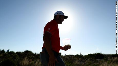 Rahm walks to the 15th fairway during the final round on Sunday.