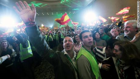 Supporters of Spanish far-right party Vox celebrate during an election night party in Seville, Andalusia.