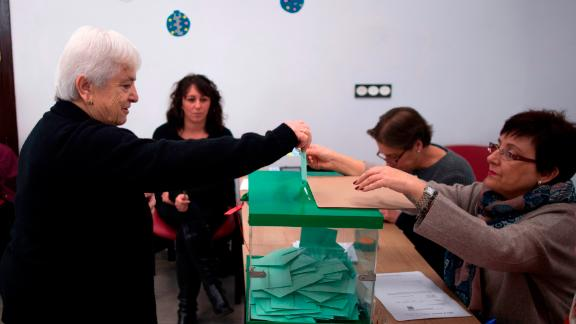 A woman casts her vote at a polling station in Carratraca near Malaga on December 2, 2018 during Andalusia's regional election.