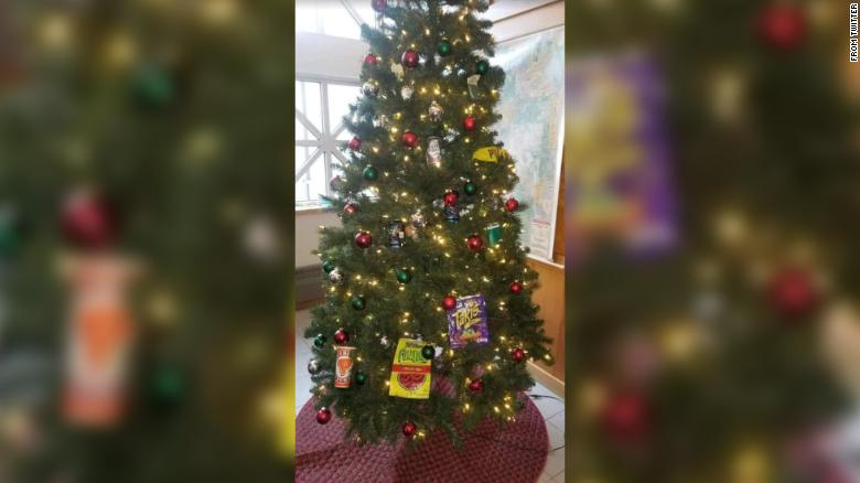 This tree in a Minneapolis police precinct was decorated with fast-food wrappers and other trash.