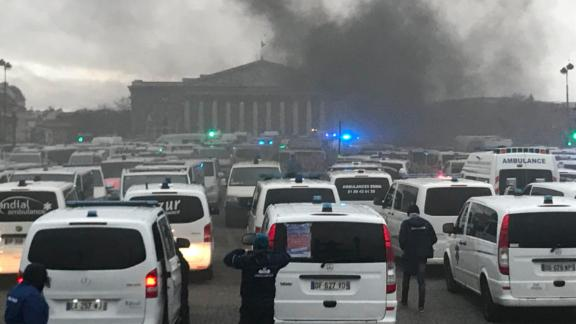 Paramedics join anti-government protests outside the National Assembly in Paris.