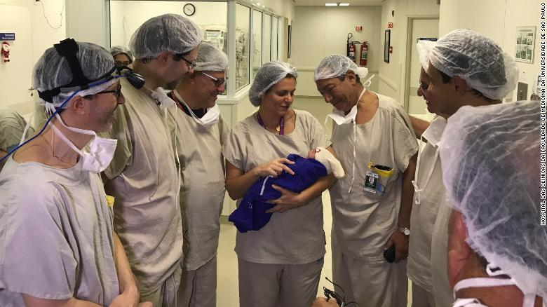 Members of the transplant and embryo transfer teams with the newborn.
