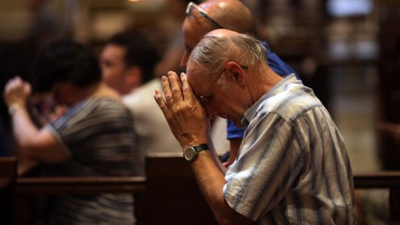 NEW YORK, NY - SEPTEMBER 08:  A man prays during mass at St. Patrick's Cathedral, the seat of the Roman Catholic Archdiocese of New York, on September 8, 2015 in New York City. Just in time for the arrival of Pope Francis later this month to hold mass at the church, a three-year restoration project at St. Patrick's is largely completed. The project at one of America's most popular churches cleaned the exterior of the church, repaired panels and stained glass windows and restored the large bronze doors at the Fifth Avenue entrance. St. Patrick's held its first Mass in 1879.  (Photo by Spencer Platt/Getty Images)