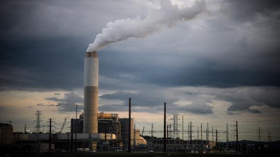 Emissions rise from the Duke Energy Corp. coal-fired Asheville Power Plant ahead of Hurricane Florence in Arden, North Carolina, U.S., on Thursday, Sept. 13, 2018. Hurricane Florences wrath hit the North Carolina coast, but the full effects of the storm, still centered 100 miles from shore, are yet to come. Photographer: Charles Mostoller/Bloomberg via Getty Images