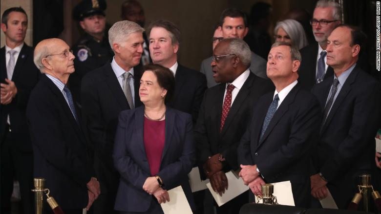 Justices of the U.S. Supreme Court including (left to right) Justices Stephen Breyer, Neil Gorsuch, Elena Kagan, Brett Kavanaugh, Clarence Thomas, Chief Justice John Roberts and Justice Samuel Alito await the arrival of the casket of former President George H.W. Bush inside at the U.S Capitol Rotunda. (Photo by Jonathan Ernst - Pool/Getty Images)