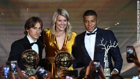 Hegerberg poses with Luka Modric (left), the men's 2018 Ballon d'Or winner, and Kylian Mbappe, the  under-21 Ballon d'Or (Koppa trophy) winner.