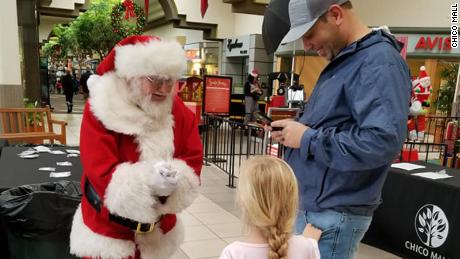 The Chico Mall Santa talks to a child during a holiday event.