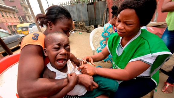 A young boy reacts as a health worker administers a measles vaccine in Lagos. Nigeria is one of three countries where up to about 8.1 million children remain un-vaccinated from measles, according to the World Health Organization.