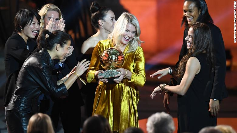 Ada Hegerberg is congratulated by her Lyon teammates after winning the 2018 Women's Ballon d'Or