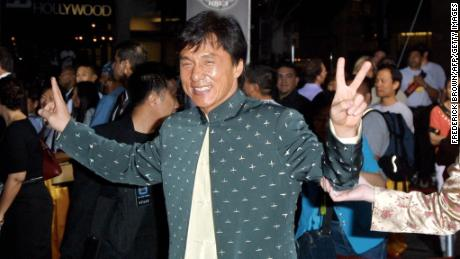 "Actor Jackie Chan poses for photographers during the world premiere of the film ""Rush Hour 2"" at the Mann's Chinese Theatre in 2001 in Los Angeles."