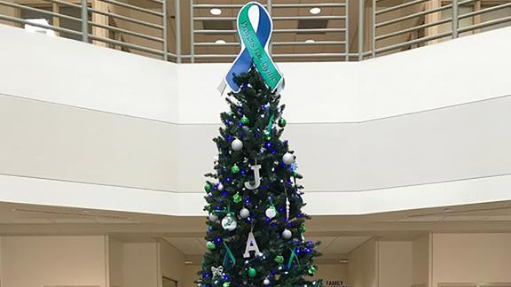 The tree features many green decorations because green has become a symbol to raise awareness of missing children.