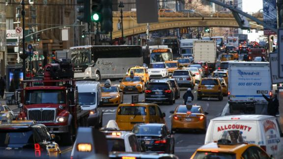 NEW YORK, NY - JANUARY 25: Traffic moves along 42nd Street in Midtown Manhattan, January 25, 2018 in New York City. New York Governor Andrew Cuomo has proposed a congestion pricing plan for vehicles entering Manhattan south of 60th Street. The plan aims to ease traffic congestion and raise money for the city's ailing transit system. The plan would have to be approved by the state legislature.