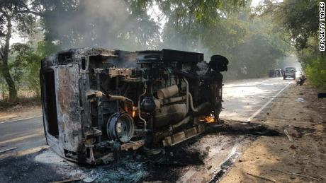 An upturned and smoldering vehicle is seen following mob violence at Chingravati village in Bulandhahr, India's northern Uttar Pradesh state, on December 3, 2018.