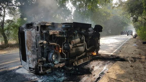 An upturned and smoldering vehicle is seen following mob violence over suspected cow slaughter in Bulandhahr, India's northern Uttar Pradesh state, on December 3, 2018.