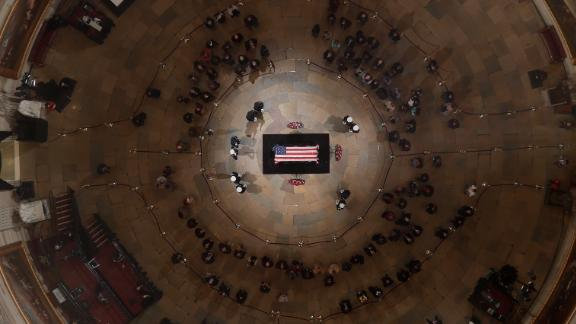 WASHINGTON, DC - DECEMBER 5:   The flag-draped casket of the late former President George H.W. Bush as he lies in state in the Capitol Rotunda on December 5, 2018 in Washington, DC.