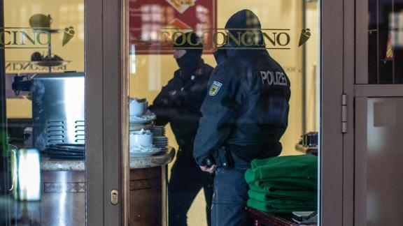 05 December 2018, North Rhine-Westphalia, Duisburg: Policemen are standing in an ice cream parlour in the Citypalais in downtown Duisburg. Investigators in Germany, Italy, the Netherlands and Belgium have raided members of the Italian mafia organisation 'Ndrangheta. Photo: Christoph Reichwein/dpa (Photo by Christoph Reichwein/picture alliance via Getty Images)