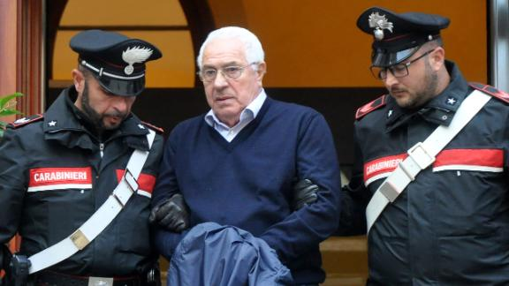 Settimino Mineo, jeweller and new head of the Sicilian mafia, is escorted by carabinieri as he leaves a police station following his arrest this week.