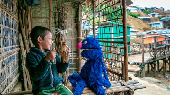The always lovable Grover plays with a boy at a Rohingya refugee camp in Cox's Bazar, Bangladesh.