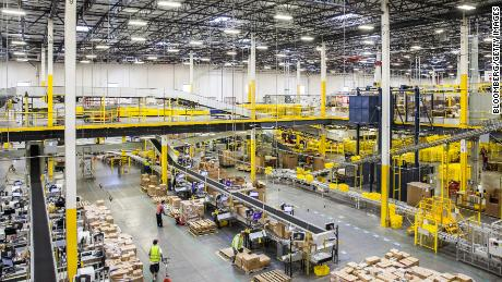 Employees move packages inside an Amazon fulfillment center in Robbinsville, New Jersey, on Nov. 28, 2016.