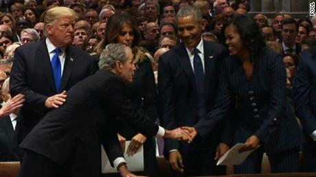 Bush shares sweet moment with Michelle Obama