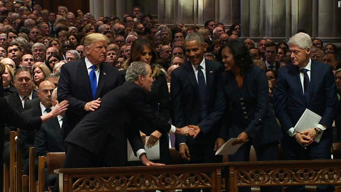 Michelle Obama and George W. Bush share a warm moment (and maybe a candy)