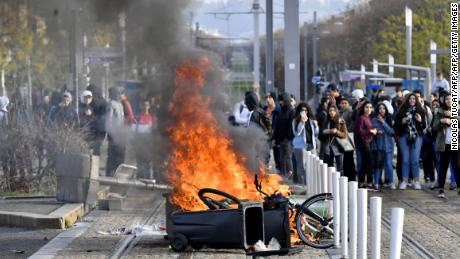 High schoolers set a barricade on fire to block a tramway during a protest Wednesday in Bordeaux.