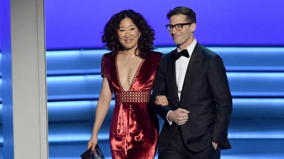 LOS ANGELES, CA - SEPTEMBER 17:  Sandra Oh (L) and Andy Samberg walk onstage during the 70th Emmy Awards at Microsoft Theater on September 17, 2018 in Los Angeles, California.  (Photo by Kevin Winter/Getty Images)