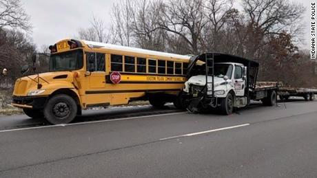 An Indiana school bus was hit by a truck Wednesday on the way to a Christmas musical, police say.