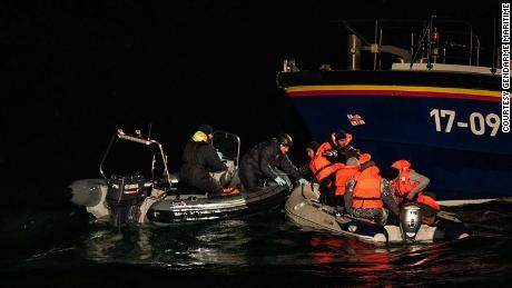 Iranian migrants traveling in a dinghy are picked up by a British lifeboat and French Maritime Police.