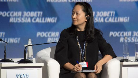 Meng Wanzhou speaking at a conference in 2014. She has been CFO of Huawei since at least 2011.